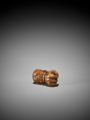 Lot 94 - MASANAO: A WOOD NETSUKE OF A LAMENTING ONI WITH RASHOMON ARM