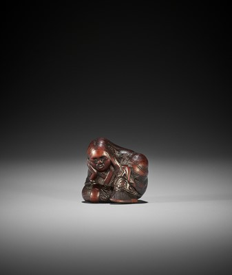 Lot 135 - SARI: A NAGOYA SCHOOL WOOD NETSUKE OF A SLUMBERING SHOJO