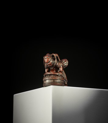 Lot 132 - ITTAN: A WOOD NETSUKE OF SHOKI CAPTURING ONI