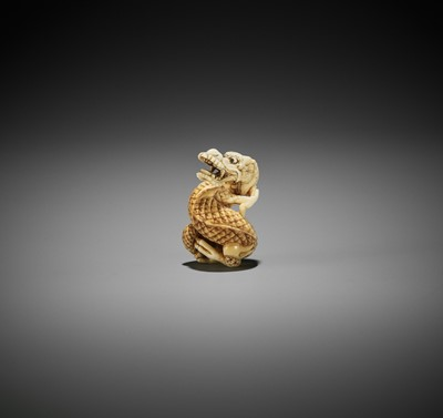 Lot 192 - AN IVORY NETSUKE OF A COILED DRAGON