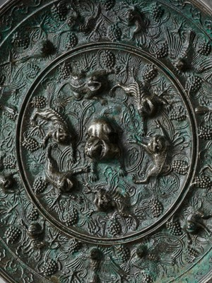 Lot 10 - A LARGE CIRCULAR BRONZE 'LION AND GRAPEVINE' MIRROR