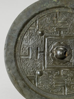 Lot 532 - A CIRCULAR BRONZE 'STYLIZED MYTHICAL ANIMALS' MIRROR