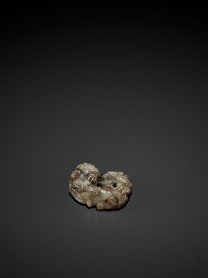 Lot 83 - AN OPENWORK JADE GROUP OF A BUDDHIST LION AND CHILONG, MING DYNASTY