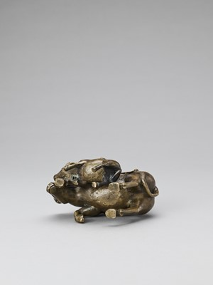 Lot 524 - A BRONZE FIGURE OF BOYS ON BUFFALOS