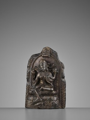 Lot 568 - A LIMESTONE STELE OF GREEN TARA