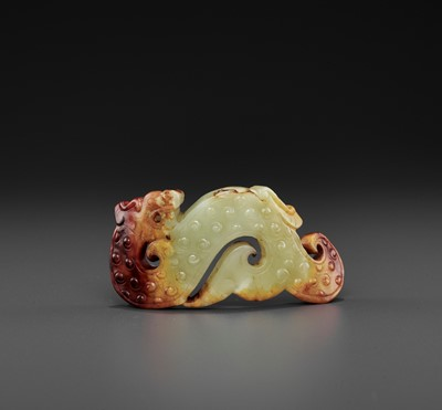 Lot 76 - A YELLOW AND RUSSET JADE 'ARCHAISTIC' WRIST ORNAMENT, SONG DYNASTY