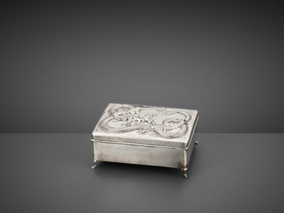 Lot 10 - A SILVER REPOUSSE 'DRAGON' BOX AND COVER, WANG HING, LATE QING TO REPUBLIC