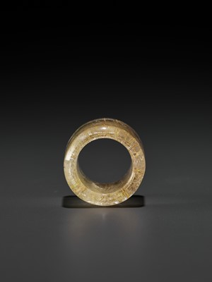 Lot 46 - A 'HAIR' CRYSTAL ARCHER'S RING, QING DYNASTY