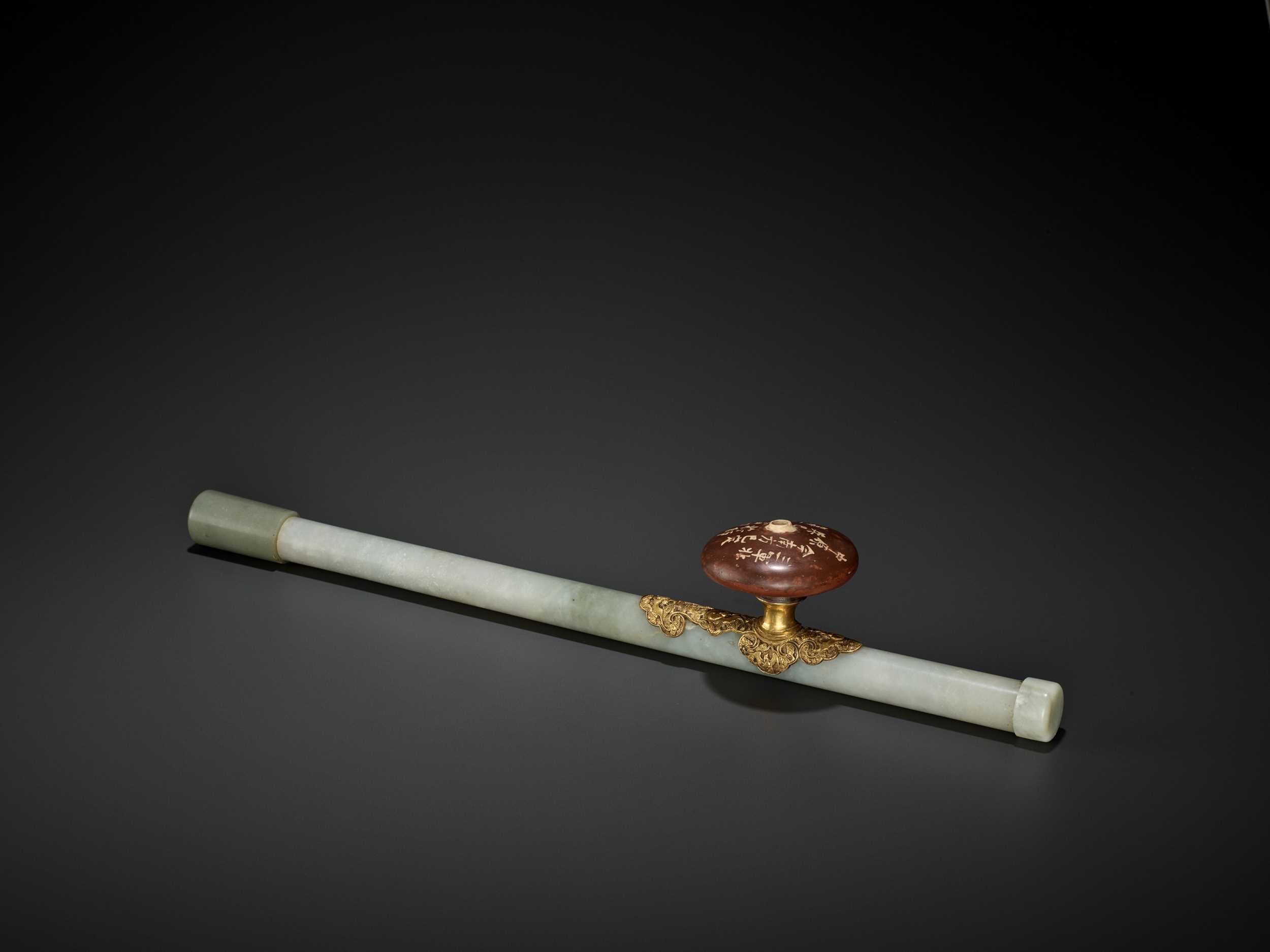 Lot 21 - A JADE AND GILT-BRONZE 'WUFU' OPIUM PIPE, QING DYNASTY