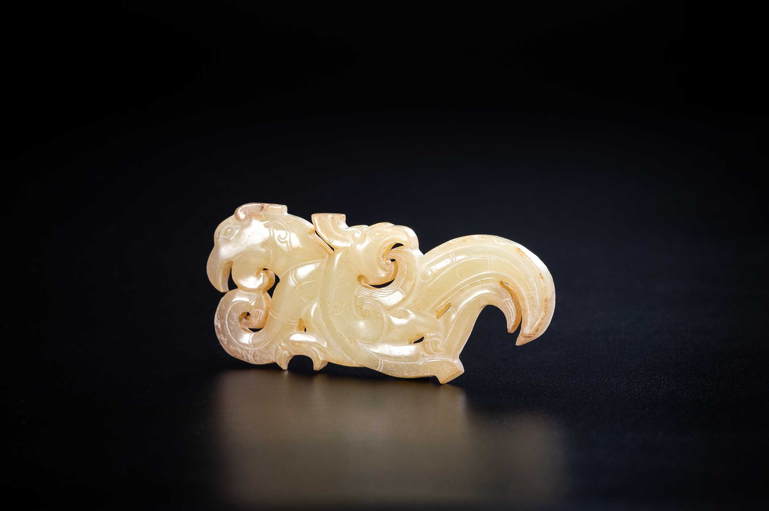 A PALE GREEN JADE CARVING WITH DRAGON AND PHOENIX, BEISHANTOU TYPE, WESTERN HAN