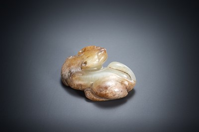 A CELADON AND RUSSET JADE CARVING OF A CAT, SONG DYNASTY