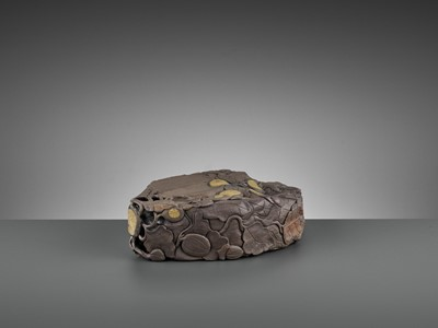 Lot 196 - A MASSIVE CARVED 'MELON' DUAN INKSTONE, EARLY QING