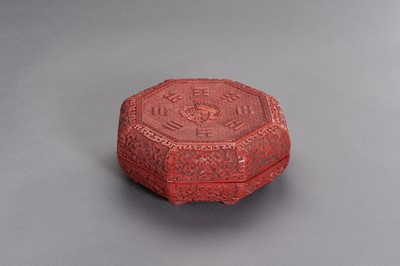 Lot 141 - AN OCTAGONAL CINNABAR LACQUER BOX AND COVER, QING DYNASTY