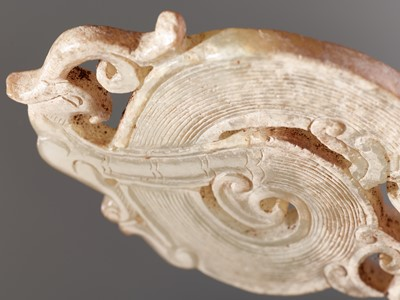 A WELL-DETAILED CARVING OF A DRAGON AND A PHOENIX IN PALE GREEN JADE