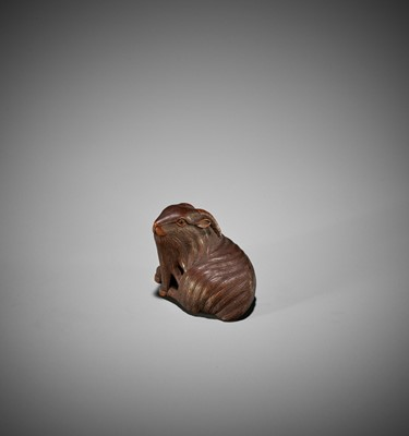 Lot 97 - MASAKIYO: A WOOD NETSUKE OF A RECUMBENT GOAT