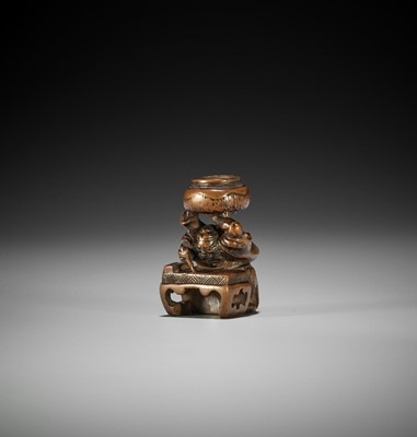 Lot 167 - KASHUN: A RARE WOOD NETSUKE OF GOSHISHO