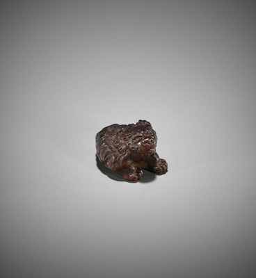 Lot 105 - KOKEI: A FINE WOOD NETSUKE OF A SHISHI