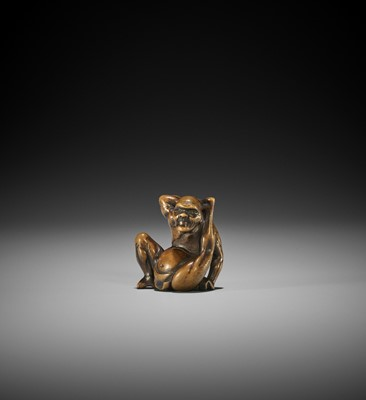 Lot 176 - AN EDO SCHOOL WOOD NETSUKE OF A CONTORTIONIST