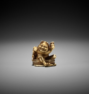 TOMOMASA: AN IVORY NETSUKE OF A BATHING ONI