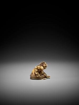 TOMOMASA: AN IVORY NETSUKE OF A BATHING ONI
