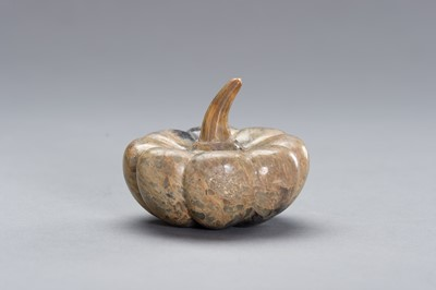 Lot 526 - A CARVED STONE DEPICTING A PUMPKIN