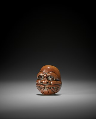 SHOZAN: A WOOD KYOGEN MASK NETSUKE OF BUAKU
