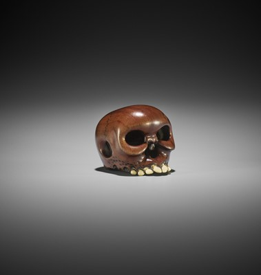 Lot 127 - IKKAN: A WOOD AND IVORY NETSUKE OF A SKULL