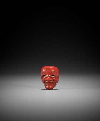 HOKEI: A MINIATURE TSUISHU (CARVED RED LACQUER) MASK NETSUKE OF OKINA (HAKUSHIKIJO)