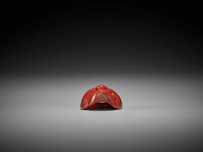 HOKEI: A MINIATURE TSUISHU (CARVED RED LACQUER) MASK NETSUKE OF OKINA (HAKUSHIKIJO)