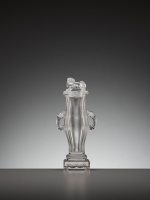 Lot 38 - A RARE ROCK CRYSTAL PARFUMIÈRE WITH A 'BUDDHIST LION' FINIAL, QIANLONG PERIOD