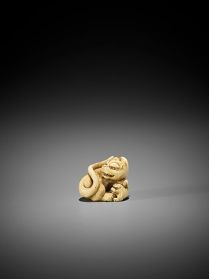 Lot 54 - RANICHI: A FINE IVORY NETSUKE OF A TIGER WITH YOUNG