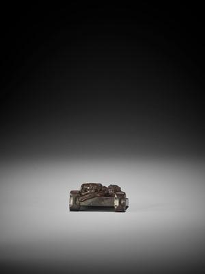 TAMETAKA: A WOOD NETSUKE OF A TSUITATE WITH TIGER AND DRAGON