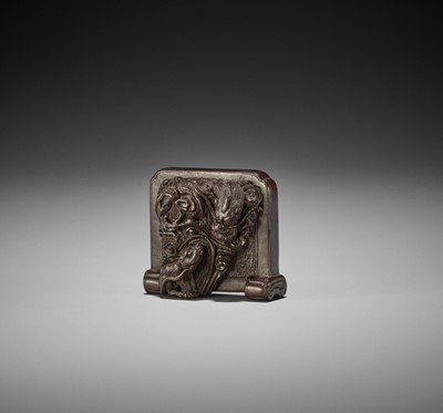 TAMETAKA: A WOOD NETSUKE OF A TSUITATE WITH TIGER AND DRAGON