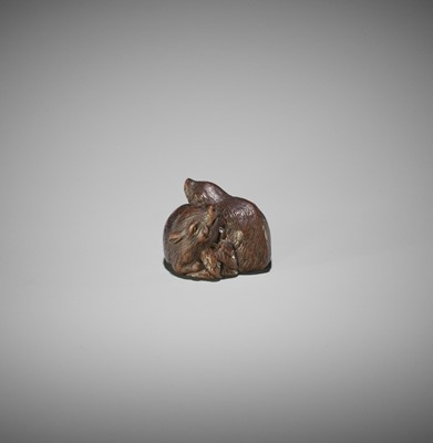Lot 125 - TAMETAKA: A WOOD NETSUKE OF TWO BOARS