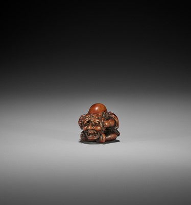 Lot 111 - MINKO: A WOOD NETSUKE OF A KARAKO WITH HANNYA MASK
