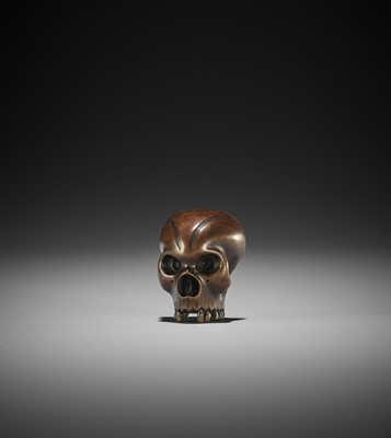 Lot 128 - A FINE WOOD NETSUKE OF A FRACTURED SKULL