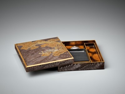 Lot 106 - A SUPERB ZESHIN-STYLE INLAID LACQUER SUZURIBAKO WITH DRAGON AMONGST CLOUDS AND COMBED WAVES