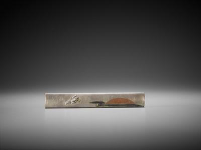 Lot 37 - OMORI TERUMITSU: AN INLAID SILVER KOZUKA WITH A FLYING CRANE AND RISING SUN