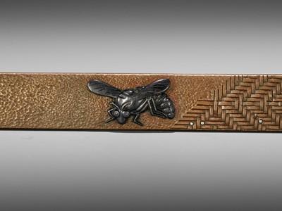 Lot 49 - A SILVER AND SHAKUDO-INLAID COPPER KOZUKA WITH A WASP