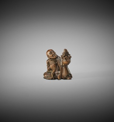 Lot 190 - GYOKUMIN: A WOOD NETSUKE OF A RAKAN WITH CARP