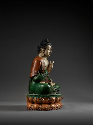 Lot 140 - A MONUMENTAL SANCAI-GLAZED FIGURE OF BUDDHA SHAKYAMUNI, MING DYNASTY