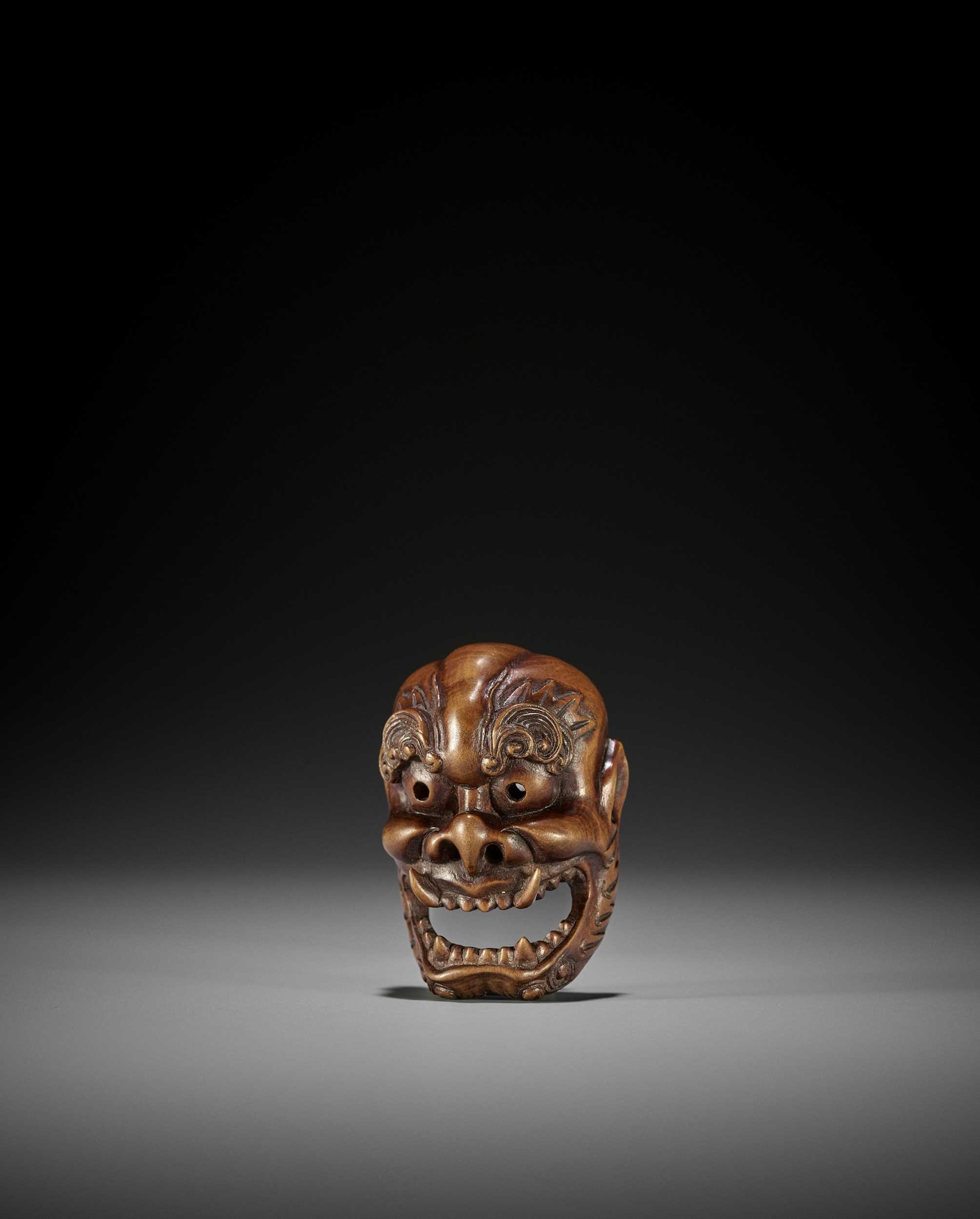 TADATOSHI: A RARE WOOD MASK NETSUKE OF RAIJIN