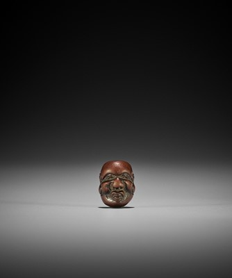 DEME: A MINIATURE WOOD MASK NETSUKE OF DAIKOKU