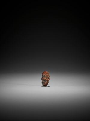 DEME: A MINIATURE WOOD MASK NETSUKE OF DAIKOKU