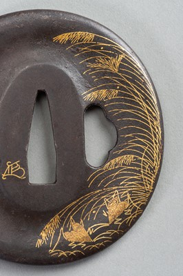 Lot 41 - AN IRON TSUBA WITH REED AND LEAF