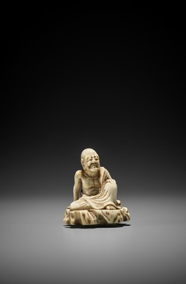 Lot 9 - AN UNUSUAL AND EARLY TOBORI STYLE IVORY NETSUKE OF A RAKAN ON A ROCK