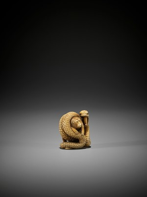 Lot 85 - KOSAI: A FINE IVORY NETSUKE OF A SNAKE WITH MONKEY