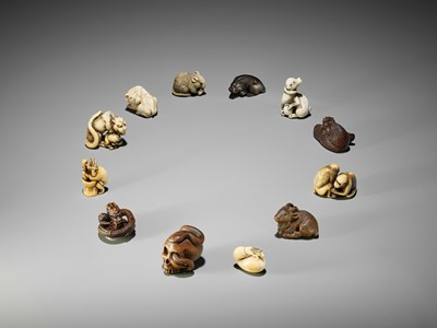 Lot 53 - TOMOTADA: AN EXCEPTIONAL IVORY NETSUKE OF A TIGRESS AND CUB