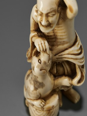 Lot 64 - AN EXCEPTIONAL IVORY NETSUKE OF A SENNIN WITH DOG ATTRIBUTED TO GECHU