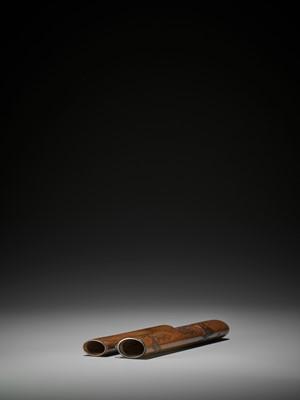 NAGIGAWA TESSO (ACTIVE EARLY-MID 20TH CENTURY): A WOOD KISERUZUTSU (PIPE CASE) DEPICTING A RAKAN AND CHILD